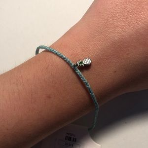 teal bracelet with pineapple charm